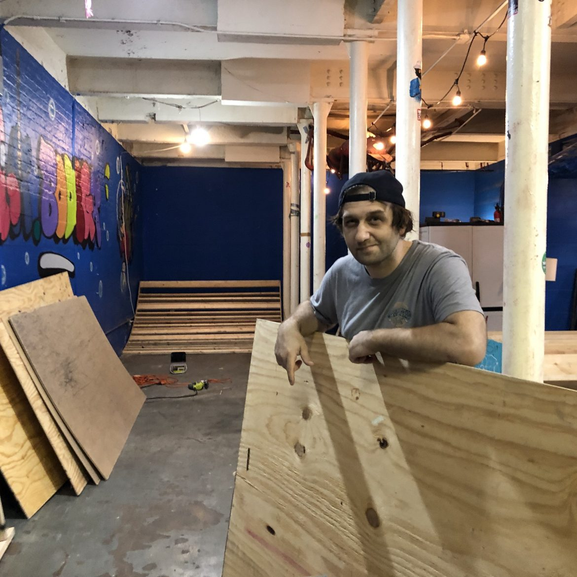 Rich posing with plywood